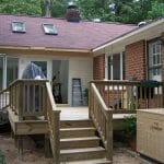 A new deck ties this sunroom addition comfortably to the existing home.